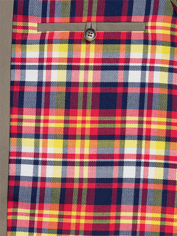 Zoom sr la doublure laine tartan de la Parka Australienne, et sur la poche passepoilée avec un bouton.