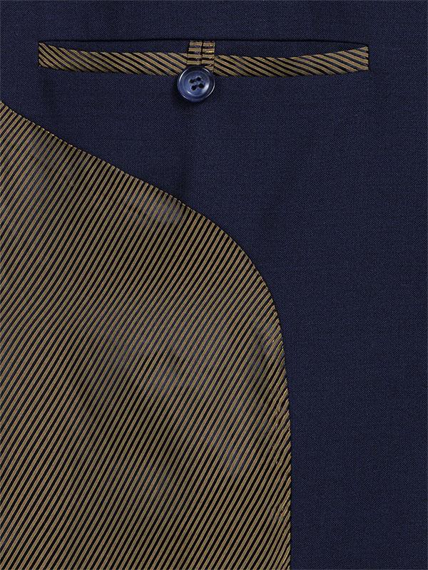 Intérieur gauche du blazer Femme bleu marine, poche simple passepoil fermée par un bouton en résine bleu, passepoil poche et doublure à diagonales fines jaune sombre et noire